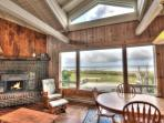 Living Room with Wood Burning Fireplace and Ocean View!
