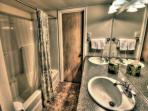 Enjoy rustic charm with a modern bathroom during your stay!