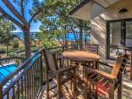 Balcony with Views of the Pool and Calibogue Sound at 1877 Beachside Tennis