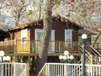 Honeymoon Cottage-rents separately- or for additonal private quarters with wrap around deck