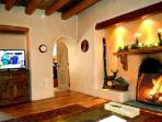 Cozy up with wood burning kiva fireplace and flat screen satellite TV
