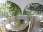 Mangoes, formal dining room,  wrought iron arches allow a pleasant breeze