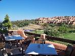 The clubhouse terrace overlooks the lake and golf course. There is a bar, restaurant and gym