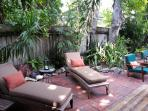 2 lounge chairs for reclining or sunbathing.