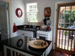 New kitchen cabinets and black granite counters.