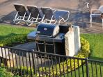 both pools are surrounded by high quality gas grills for your use