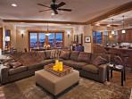 Lower living area with a large gas fireplace.