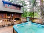 Secluded, with a private hot tub and lodge-like interior!