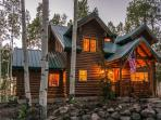 Lake Creek Cabin with Snowmobile Rentals, Private Outdoor Hot Tub and Breathtaking Mountain Views