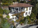 Villa Bella Vista with its lush gardens and 2 south facing terraces overlooking Lago Maggiore