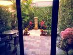 Back patio with fountain. Siting and lounge area,