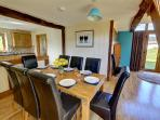 The elegant dining area a has a good sized dining table and eight chairs
