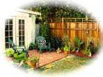 Our backyard patio & garden is framed by fountains and fruit trees
