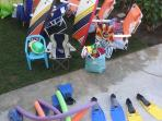 Snorkeling mask, fins, beach chairs, umbrellas, and beach toys provided