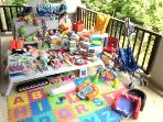 Baby's and children stuff ,toys, 15 barbies,high chair,carry baby,sleeping bag ,blanket,pillow .