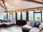 The sunroom with (very) comfortable seating and stunning garden views