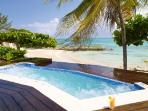 Four Winds- sheltered cove on private beach, freshwater pool & full staff