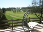 Relax on the luxury hammocks on the large balcony and watch the golfers