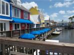5 minute walk to this waterfront Plaza to rent many water sport activities
