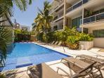 The pool is over 60 feet, with lush tropical gardens