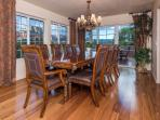 Dining room with seating for 8 with views. Joins the outside patio with additional seating.