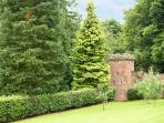 The castle folly at the end of the archery lawn of Melmerby Hall, converted to a play area