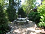 Side Yard Grilling & Picnic area Overlooks the Water & Woods.