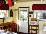 Fully equipped kitchen, with two ovens, stove, microwave, blender, everything needed to cook.