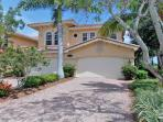 Pristine Fiddler's Creek home with stunning golf course and lake views!