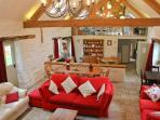 Cook, eat and relax together in the huge oak-beamed kitchen, dining area and lounge