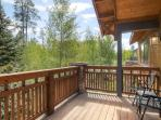 Walk out of the dining area onto the patio with beautiful wooded and mountain views.