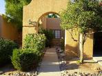 Arched entryway from beautiful citrus tree lined street