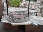 Newly built stone BBQ and spit roast at the side of front terrace