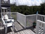 South-facing deck with full sun exposure offers stunning views on forest and sky