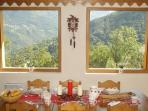 Chalet dining area stunning views  - imagine how amazing this view is in the white winters!