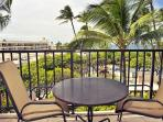 The lanai provides a small table and a peek-a-boo ocean view