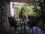 new Canopy Dining Area with gas grill and fenced side yard for your pet and Very Private.
