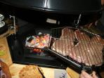 Sizzle steaks on the flame