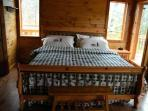 King Bed in Master Bedroom at Rocky Top Lodge