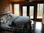 King Bedroom with Deck Access at Rocky Top Lodge