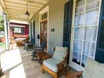 Relax and enjoy on the comfortable porch on the tree lined street with free parking