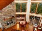 Floor to ceiling windows in living/dining area with gorgeous mountain views.