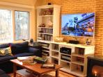 Cozy Living room with HUGE 3D TV, 200 Channels and dozens of videos and games. Fun for all