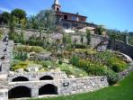 ... set in an acre of spectacular private south-facing landscaped gardens with many sitting areas.
