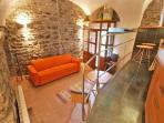 In the ground floor cantina apartment contemporary design complements 14C walls.