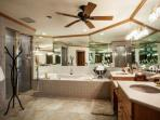 Spacious Master Bathroom with double vanity, awl-in shower and separate jetted tub.