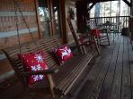 Comfy covered deck to enjoy the beautiful scenery.