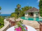 Silent Waters Villa owners villa pool, sundeck and bedroom with view of the sea