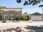 New Listing! Vibrant & Spacious 4BR North Beach House w/Wifi, Tiki Bar on Private Deck & Outdoor Shower – Walking Distance from the Ocean, Bay, Shopping & More!