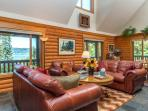 Great room looking southwest.  Over-sized leather furniture and bay views.